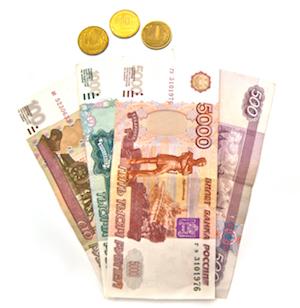 Bild på ryska rubelmynt och rubelsedlar